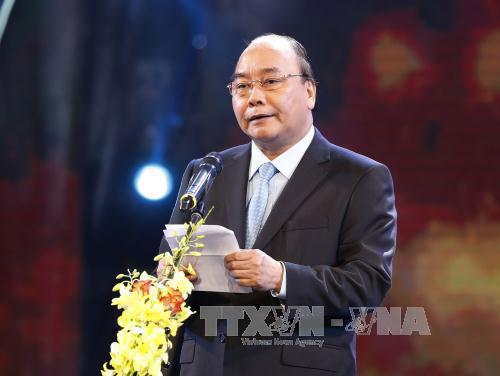 """Thủ tướng Chính phủ Nguyễn Xuân Phúc phát biểu tại Chương trình """"Bảo hiểm y tế toàn dân - Chung tay vì sức khỏe cộng đồng"""